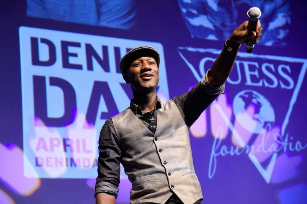 Denim Day 2015 Spokesperson and recording artist Aloe Blacc performs onstage at the GUESS and Peace Over Violence press conference for the 16th annual Denim Day at GUESS? Inc. Headquarters on April 29, 2015 in Los Angeles, California