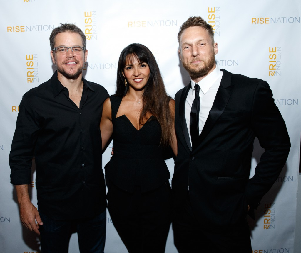 Actor Matt Damon, wife Luciana Barroso and personal/celebrity trainer Jason Walsh attend 'Rise Nation Fitness Studio's Los Angeles Grand Opening' on August 21, 2015 in West Hollywood, California