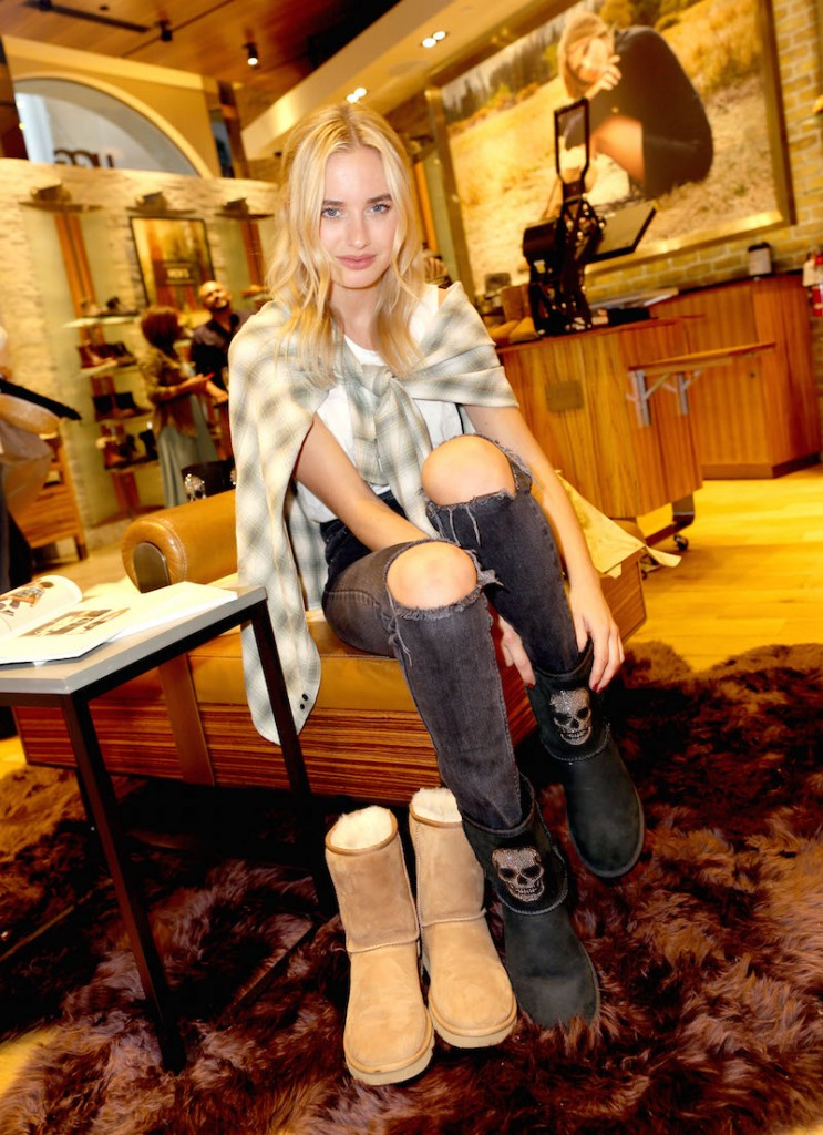 Sonya Esman shows off the pair of UGG classics with Swarovski crystals she designed during UGG and Sonya Esman of Class Is Internal celebrate UGG Season on September 23, 2015 in Los Angeles, California