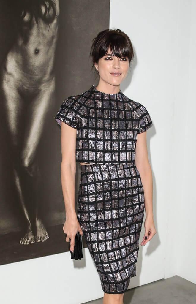 Actress Selma Blair arrives wearing Christian Siriano at