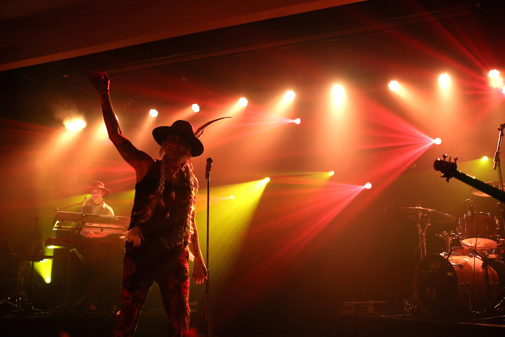 Adam Lambert performs onstage at his Ghost Town Halloween Party hosted by Hilton@PLAY at The Beverly Hilton on October 31, 2015 in Beverly Hills, California