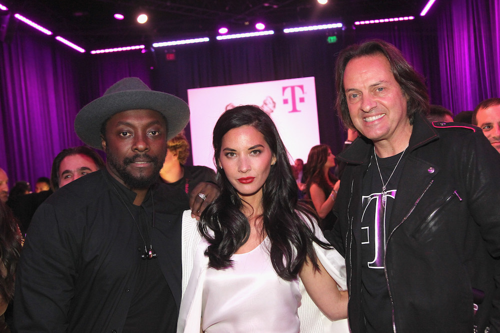 (L-R) Singer-songwriter will.i.am, actress Olivia Munn and President and CEO of T-Mobile John Legere attend T-Mobile Un-carrier X Launch Celebration at The Shrine Auditorium on November 10, 2015 in Los Angeles, California