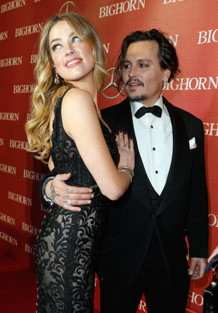 Actors Amber Heard (L) and Johnny Depp attend the 27th Annual Palm Springs International Film Festival Awards Gala at Palm Springs Convention Center on January 2, 2016 in Palm Springs, California