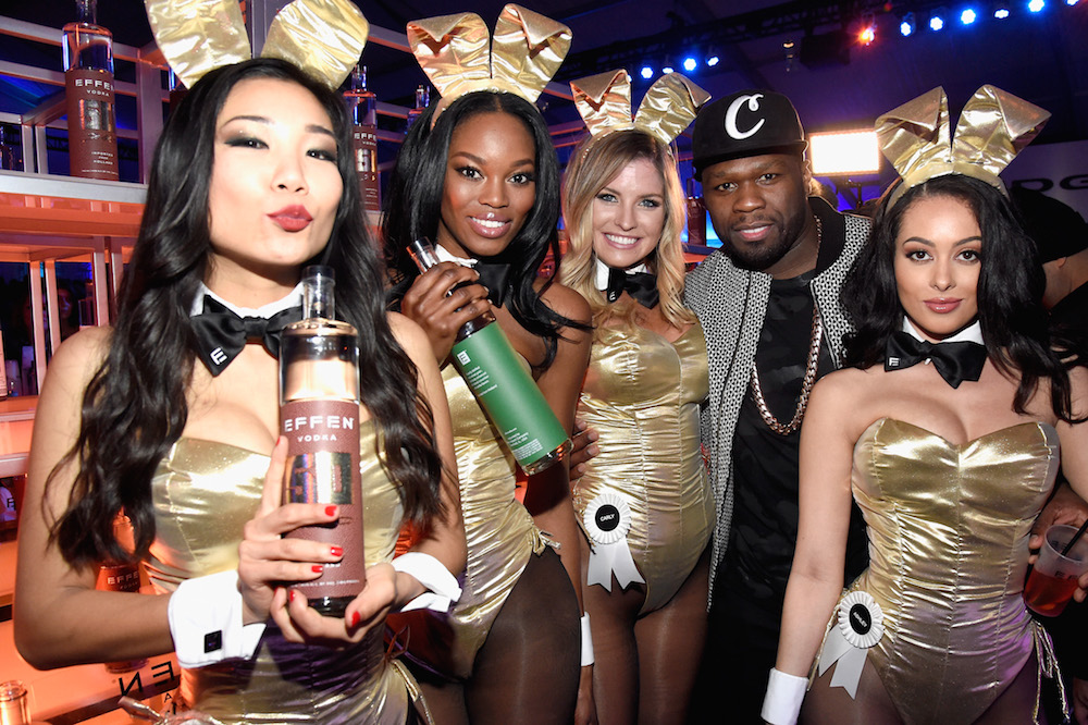 (L-R) Rapper and entrepreneur 50 Cent attends the The Playboy Party during Super Bowl Weekend with Playboy Playmates Hiromi Oshima, Eugena Washington, Carly Lauren and Ashley Doris wearing Bunny costumes inspired by the gold detailing on his limited edition EFFEN Vodka football bottle. The Playboy Party celebrated the future of Playboy and its newly redesigned magazine in a transformed space within Lot A of AT&T Park on February 5, 2016 in San Francisco, California