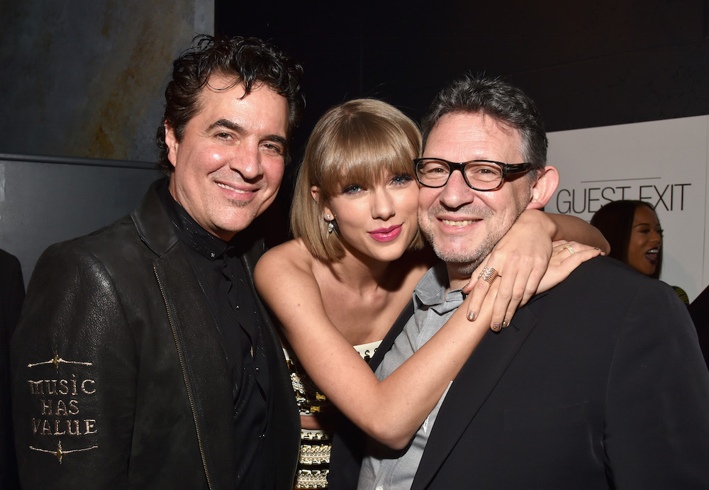 (L-R) Founder of Big Machine Records Scott Borchetta, singer-songwriter Taylor Swift and CBE Chairman & CEO UMG Lucian Grainge attend Universal Music Group 2016 Grammy After Party presented by American Airlines and Citi at The Theatre at Ace Hotel Downtown LA on February 15, 2016 in Los Angeles, California