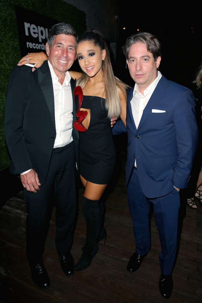 Recording artist Ariana Grande (C) and Executive Vice President of Republic Records Charlie Walk (R) attend the Republic Records Grammy Celebration presented by Chromecast Audio at Hyde Sunset Kitchen & Cocktail on February 15, 2016 in Los Angeles, California
