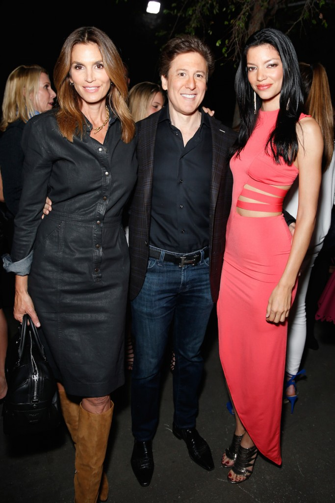 (L-R) Model/Best Buddies Global Ambassador Cindy Crawford, radio personality Paul Weinberg, and model Shay Londre, wearing Sen, attend Best Buddies