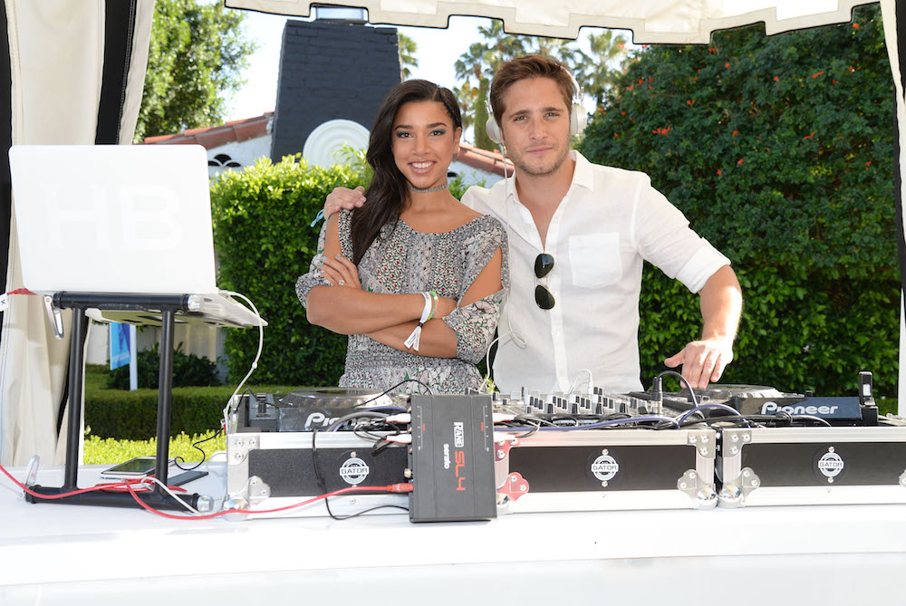 DJ Hannah Bronfman (L) and singer Diego Boneta attend Emily Ratajkowski hosts Sunset Kickoff at the POPSUGAR Cabana Club on April 15, 2016 in Palm Springs, California