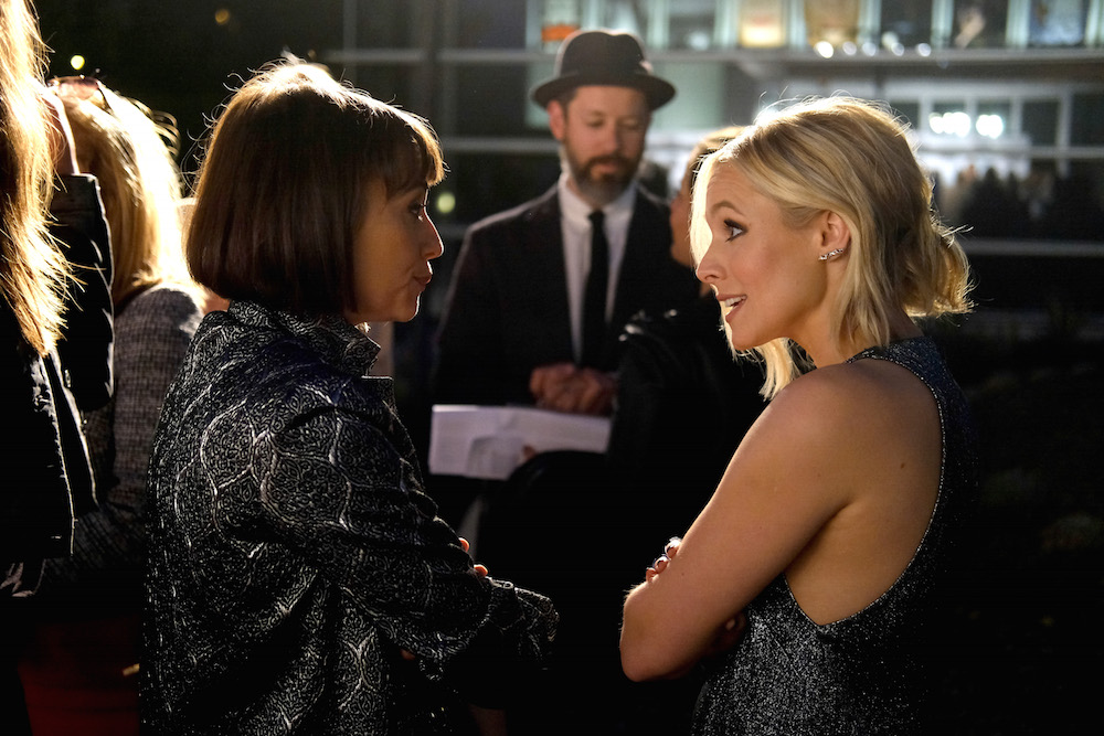 Actresses Rashida Jones (L) and Kristen Bell attend the opening of REFUGEE Exhibit at Annenberg Space For Photography on April 21, 2016 in Century City, California