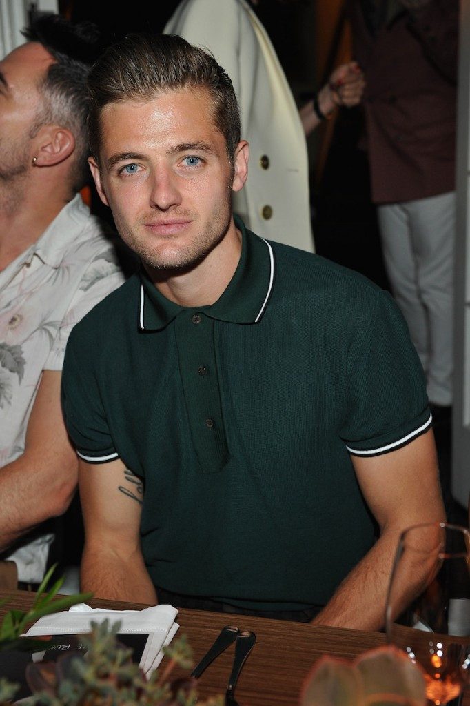 Robbie Rogers, wearing Bally, attends Bally Dinner, celebrating Beverly Hills flagship store opening, on April 21, 2016 in Los Angeles, California
