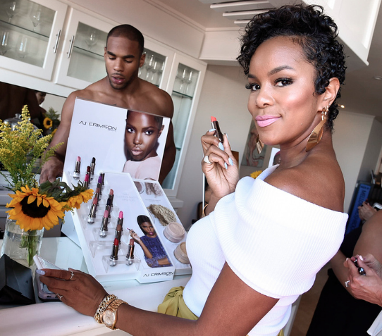 LeToya Luckett touched up her lipstick at the Kia Malibu Beach House with AJ Crimson Beauty