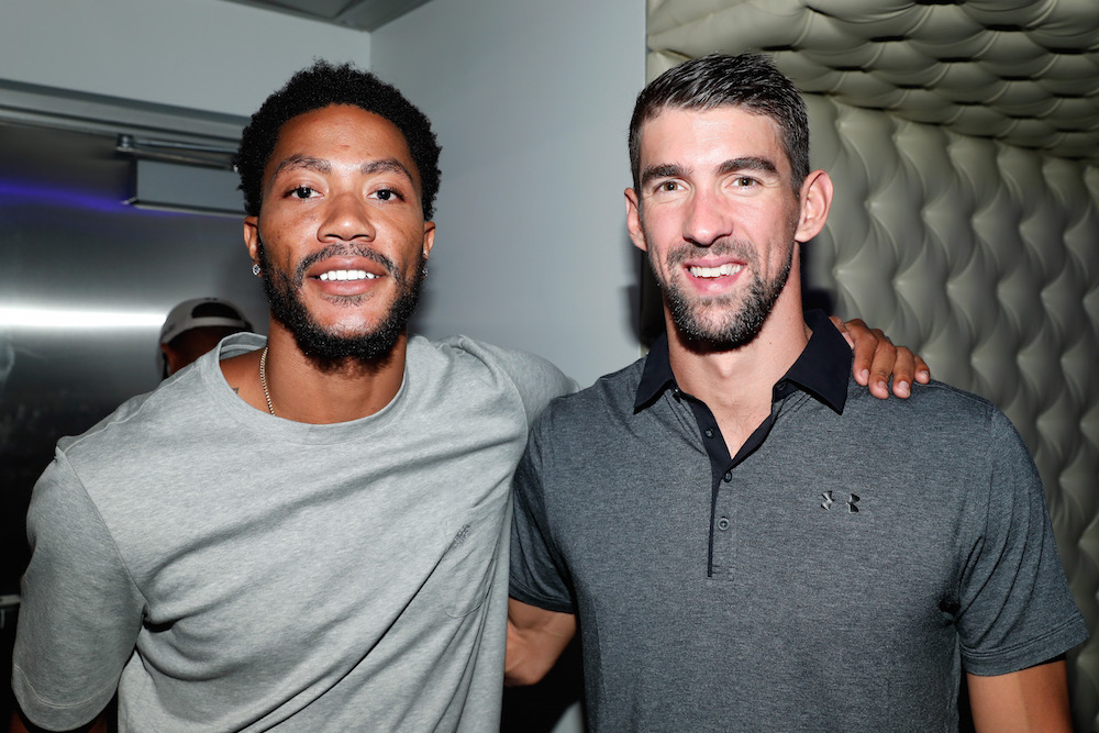 NBA player Derrick Rose (L) and Olympic swimmer Michael Phelps attend The Ultimate Fan Experience, Call Of Duty XP 2016 presented by Activision at The Forum on September 2, 2016 in Inglewood, California