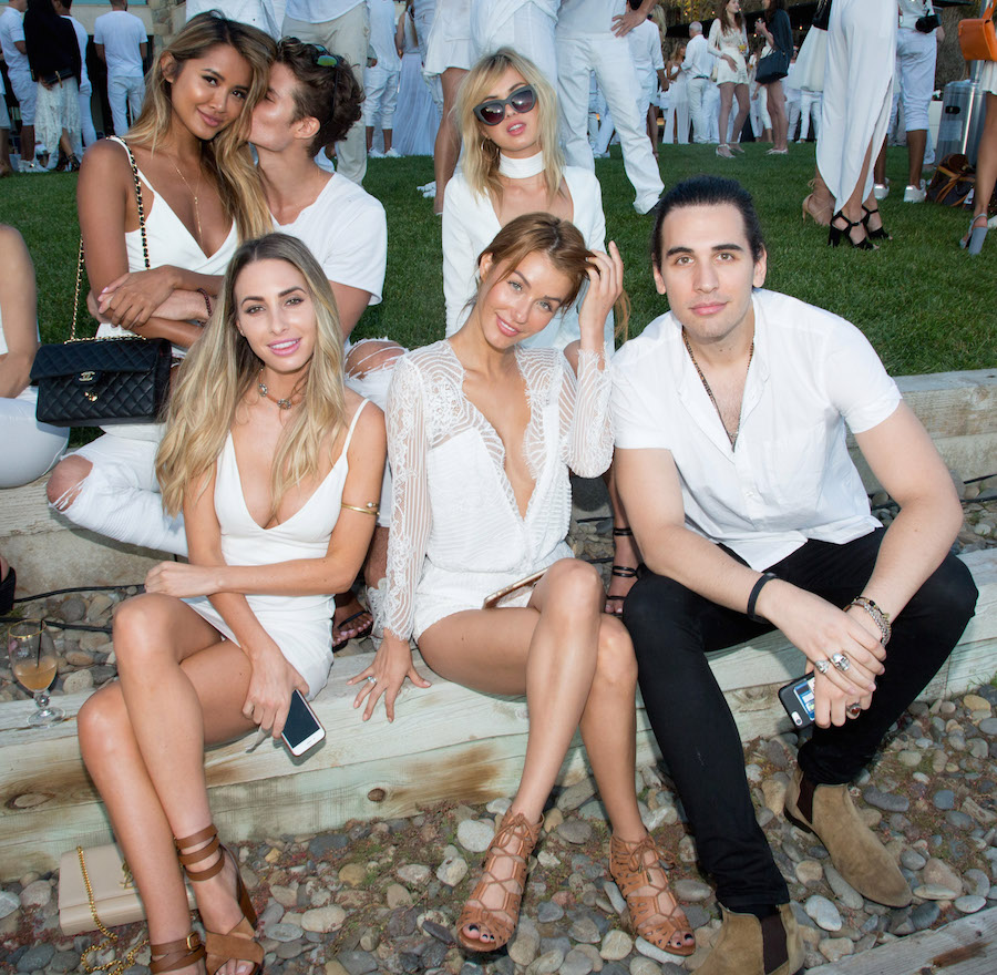 Nick Simmons (R) and guests attend the Treats! Magazine 4th Annual White Party Sponsored By Stella Artois on September 17, 2016 in Malibu, California