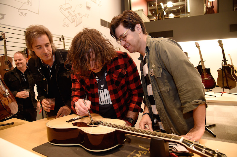 Musician Ryan Adams (C) and Tod Wisenbaker (R) attend the Fender Hollywood office Grand Opening with exclusive performances By Cold War Kids and Bleached on September 22, 2016 in Los Angeles, California