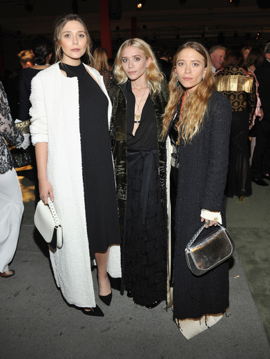 Elizabeth Olsen, Ashley Olsen and Mary-Kate Olsen attend the 2016 LACMA Art + Film Gala Honoring Robert Irwin and Kathryn Bigelow Presented By Gucci at LACMA on October 29, 2016 in Los Angeles, California