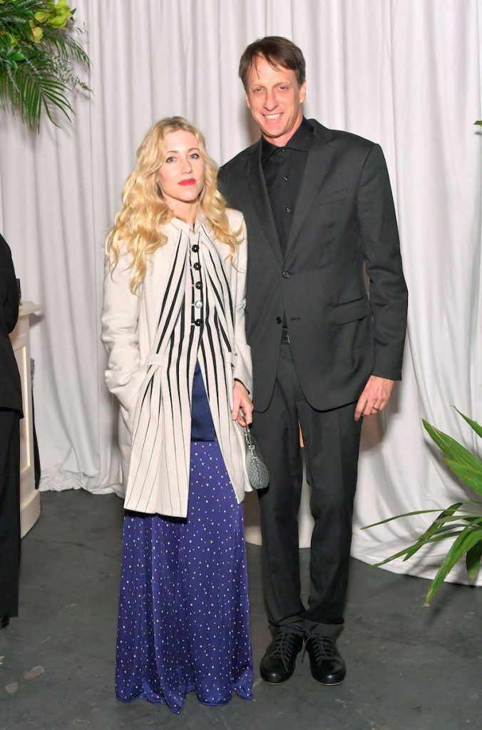 Catherine Goodman (L) and pro skateboarder Tony Hawk attend The Art of Elysium presents Stevie Wonder's HEAVEN - Celebrating the 10th Anniversary at Red Studios on January 7, 2017 in Los Angeles, California