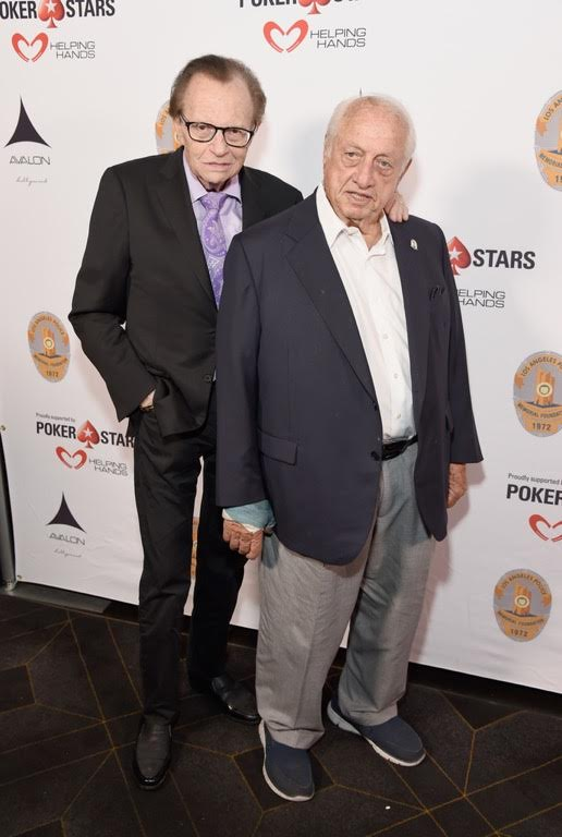 Larry King, who just revealed that he survived lung cancer, gave pal Tommy Lasorda a pat on the back as they celebrated Tommy's 90th birthday at the Heroes for Heroes: Los Angeles Police Memorial Foundation Celebrity Poker Tournament & Casino Night Party