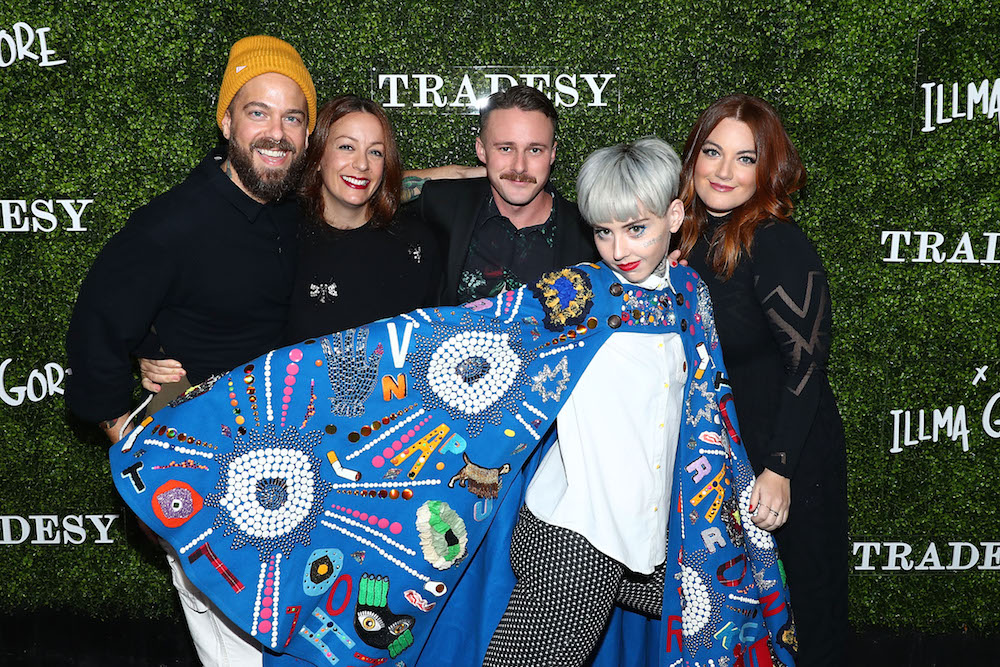 Artist Illma Gore (in cape) Erica Summers (R) and guest attend the Tradesy Showroom Opening on November 8, 2017 in Santa Monica, California