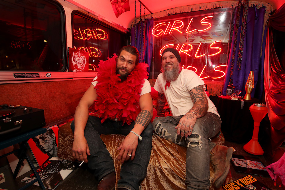Jason Momoa (L) and artist Blaine Halvorson attend Mastercard and Fred Segal Present 'Rock n Roll Holy Land' An Exclusive and Interactive Experience by MadeWorn on April 10, 2018 in West Hollywood, California
