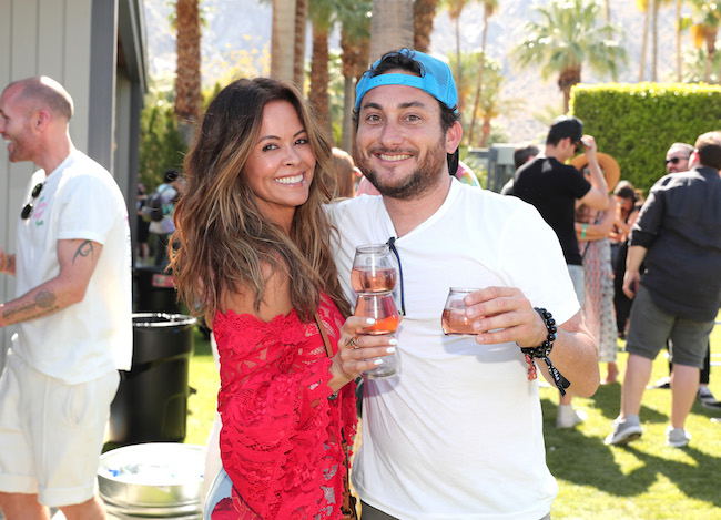 Brooke Burke (L) and Daniel Sena attend Interscope Coachella House 2018 on April 14, 2018 in Palm Springs, California