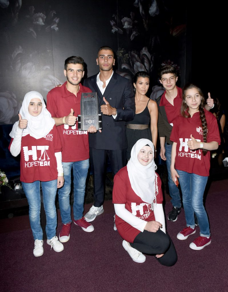Younes Bendjima, Kourtney Kardashian and Syrian Refugees from the Hope for Syria Robotics Team attend SAMS Benefit for Syrian Refugees on May 4, 2018 in Beverly Hills, California
