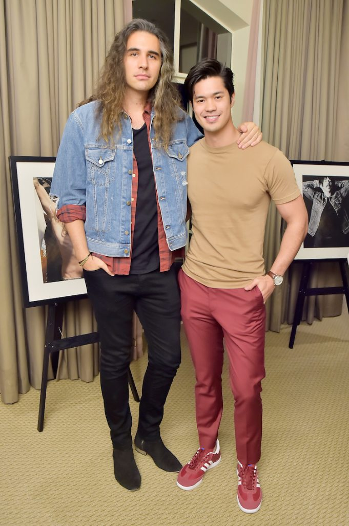 Nick Simmons (L) and Ross Butler attends= Diesel Presents Scott Lipps Photography Exhibition 'Rocks Not Dead' at Sunset Tower on June 28, 2018 in Los Angeles, California