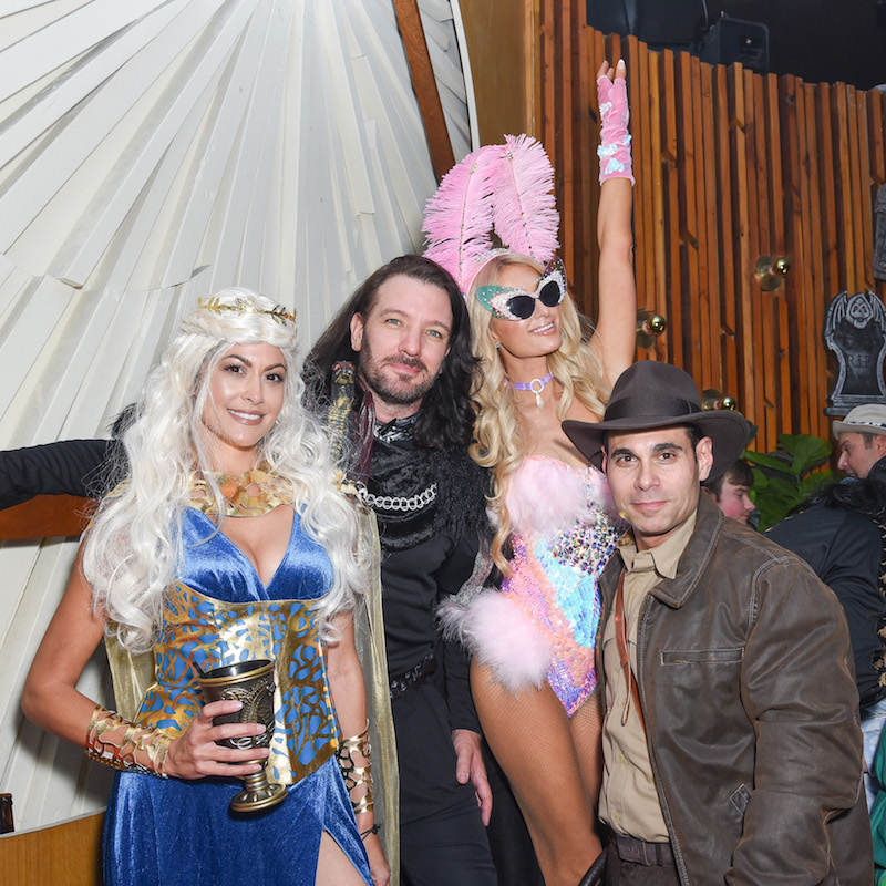 Guests, Paris Hilton and Eric Podwall attend Podwall Entertainment's 9th Annual Halloween Party Presented By Makers Mark at The Peppermint Club on October 31, 2018 in Los Angeles, California