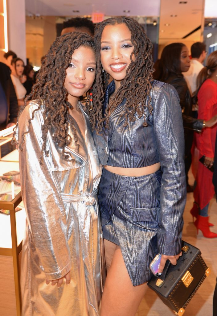 Halle Bailey (L) and Chloe Bailey attend the MCM Rodeo Drive Store Grand Opening Event at MCM Rodeo Drive on March 14, 2019 in Beverly Hills, California
