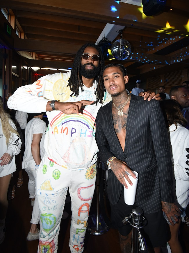 DeAndre Jordan and Jordan Clarkson attend the 'Red, White and Bootsy' annual July 4th bash, presented by REVOLVE and The h.wood Group on July 04, 2021 in Malibu, California