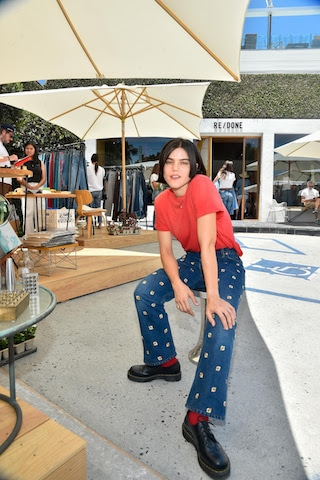 Musician, Soko, Host of Flea Market wearing RE/DONE Heritage Cotton Classic Tee in Faded Crimson and 70s Loose Flare Jean in Indigo